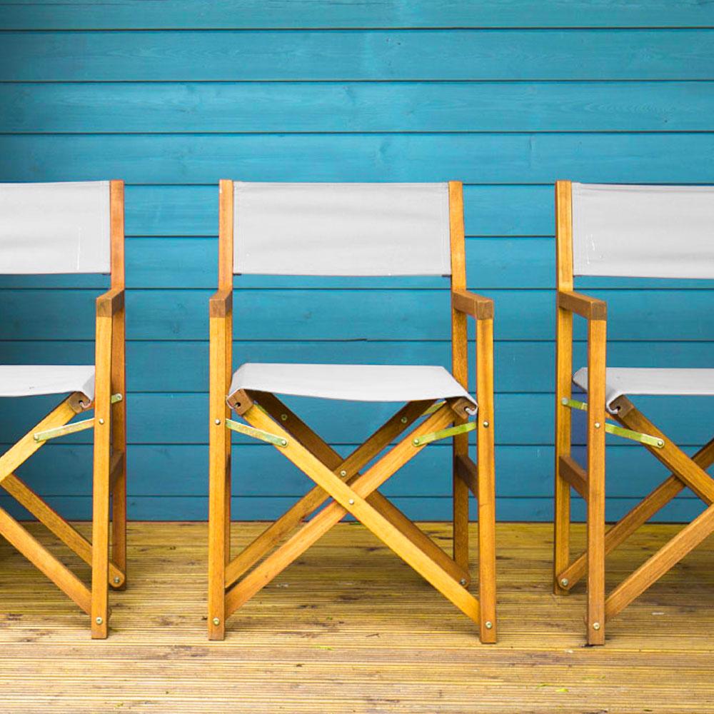 Canvas Chairs Against Beach Hut
