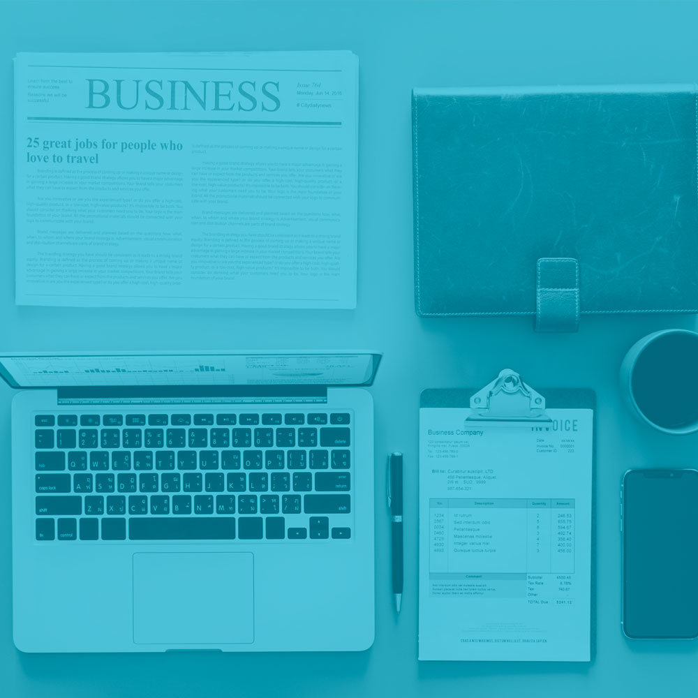 Various Business Items On A Desk