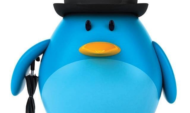 Picture Of A Blue Penguin With Black Bowler Hat And Umberella