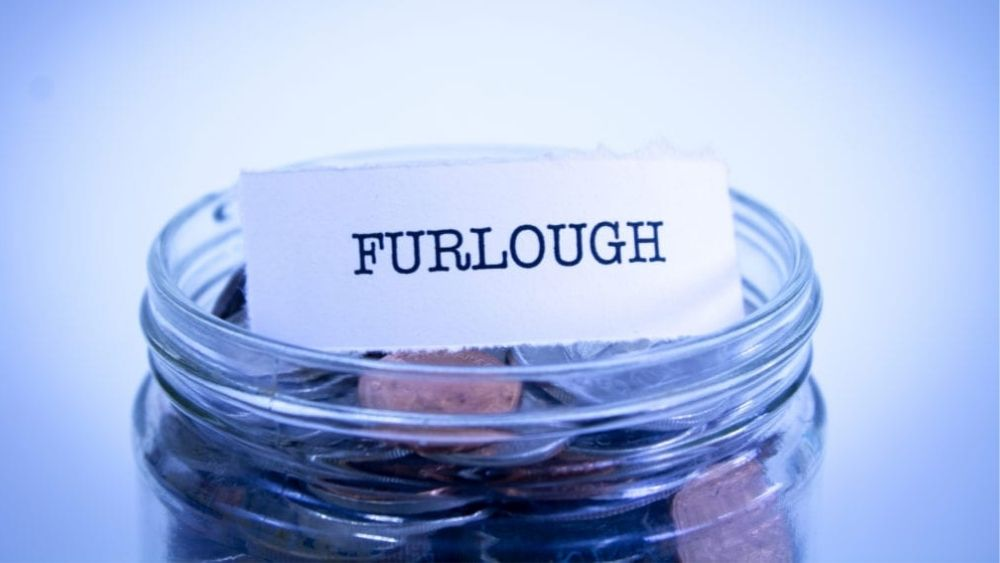jar with changes to the furlough scheme on a piece of paper sat inside.