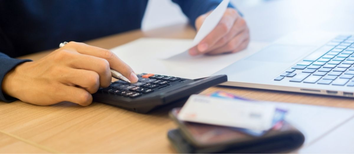 a fixed fee accountants hand calculating payroll cost