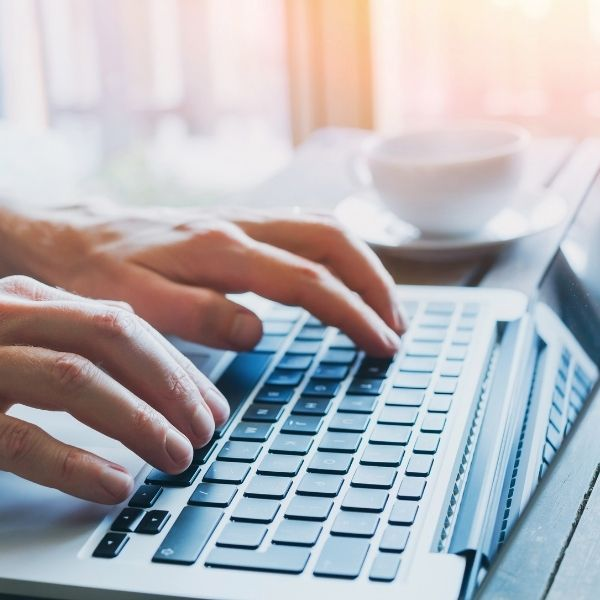 hand on laptop choosing a fixed fee accounting package