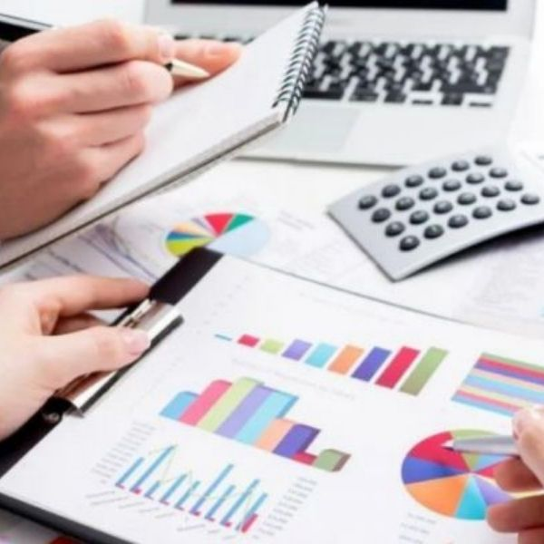 hands looking at financial graphs to get ready for making tax digital with sage accounting software